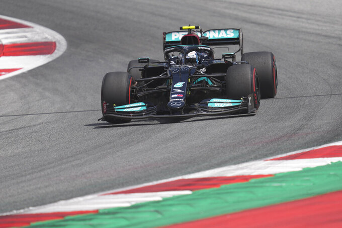 Mercedes driver Valtteri Bottas of Finland steers his car during the first practice at the Red Bull Ring racetrack in Spielberg, Austria, Friday, June 25, 2021. The Styrian Formula One Grand Prix will be held on Sunday, June 27, 2021. (AP Photo/Darko Vojinovic)