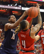 Notre Dame forward Juwan Durham (11) battles with Louisville guard Khwan Fore (4) for a rebound during the first half of an NCAA college basketball game in Louisville, Ky., Sunday, March 3, 2019. (AP Photo/Timothy D. Easley)