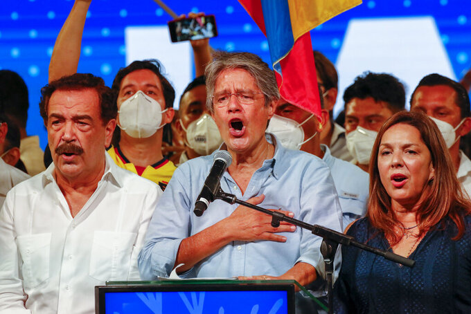 Guillermo Lasso, presidential candidate of Creating Opportunities party, CREO, center, celebrates with his wife María de Lourdes Alcívar, right, after a presidential runoff election at his campaign headquarters in Guayaquil, Ecuador, Sunday, April 11, 2021. With most of the votes counted Lasso, a former banker, had a lead over economist Andres Arauz, a protege of former President Rafael Correa.(AP Photo/Angel Dejesus)