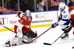 Florida Panthers goaltender Spencer Knight (30) stops a shot on the goal by Tampa Bay Lightning left wing Alex Killorn (17) during the first period in Game 5 of an NHL hockey Stanley Cup first-round playoff series, Monday, May 24, 2021, in Sunrise, Fla. (AP Photo/Lynne Sladky)