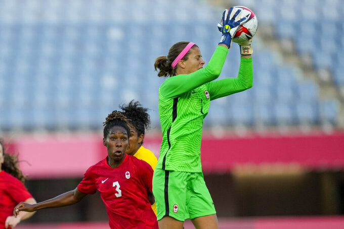 Canada's goalkeeper Stephanie Labbe intercepts a shot during a women's quarterfinal soccer match against Brazil at the 2020 Summer Olympics, Friday, July 30, 2021, in Rifu, Japan. (AP Photo/Andre Penner)