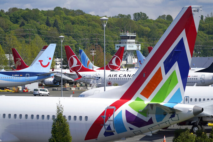 Boeing 737 Max airplanes sit parked in a storage lot, Monday, April 26, 2021, near Boeing Field in Seattle.  Boeing is paying $17 million and promising to take steps to fix production problems with its popular 737 jets. The Federal Aviation Administration said Thursday, May 27,  that the settlement covers the installation of unapproved sensors and other parts on some Boeing 737 models including NGs and the Max.   (AP Photo/Ted S. Warren)