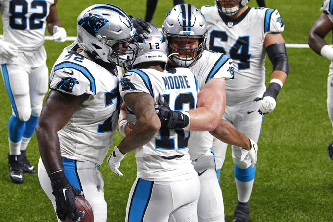 Carolina Panthers wide receiver D.J. Moore (12) celebrates his touchdown reception with teammates in the first half of an NFL football game against the New Orleans Saints in New Orleans, Sunday, Oct. 25, 2020. (AP Photo/Butch Dill)