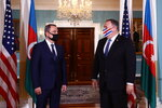CORRECTS NAME TO AZERBAIJAN FOREIGN MINISTER JEYHAN BAYRAMOV - Secretary of State Mike Pompeo walks out to face reporters with Azerbaijan Foreign Minister Jeyhun Bayramov, prior to holding talks, Friday, Oct. 23, 2020 at the State Department in Washington. (Hannah McKay/Pool via AP)