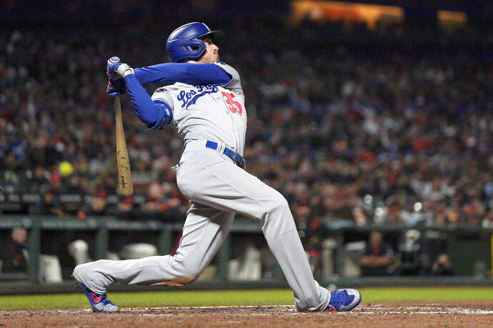 FILE - This Sept. 27, 2019, file photo shows Los Angeles Dodgers' Cody Bellinger (35) getting a hit against the San Francisco Giants during a baseball game in San Francisco. Bellinger was well on his way to becoming the National League MVP only 60 games into last season for the Los Angeles Dodgers, already with 20 homers in that stretch before his 24th birthday. (AP Photo/Tony Avelar, File)