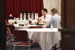 In this March 20, 2020, photo Sen. Rand Paul, R-Ky., right, Sen. Marco Rubio, R-Fla., left, have lunch at a Republican policy lunch on Capitol Hill in Washington. Paul tested positive for the coronavirus. (AP Photo/Susan Walsh)