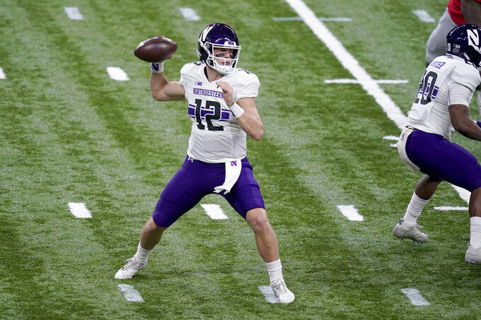 Northwestern quarterback Peyton Ramsey throws during the first half of the Big Ten championship NCAA college football game against Ohio State, Saturday, Dec. 19, 2020, in Indianapolis. (AP Photo/Darron Cummings)
