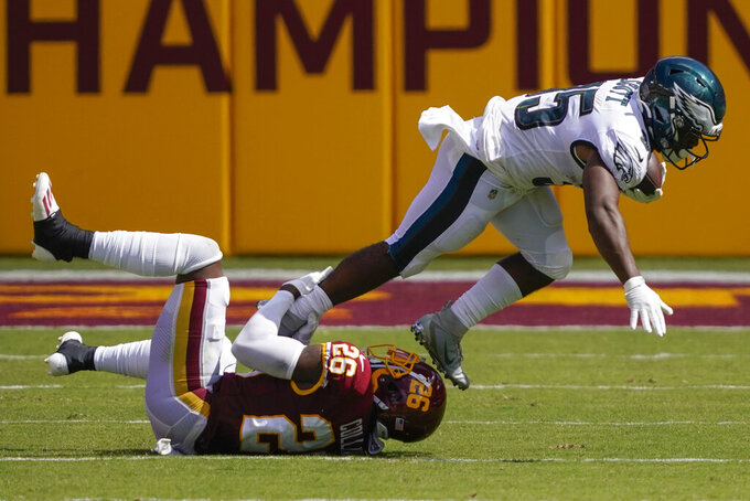 Philadelphia Eagles running back Boston Scott (35) is tackled by Washington Football Team strong safety Landon Collins (26) during the second half of an NFL football game, Sunday, Sept. 13, 2020, in Landover, Md. (AP Photo/Alex Brandon)