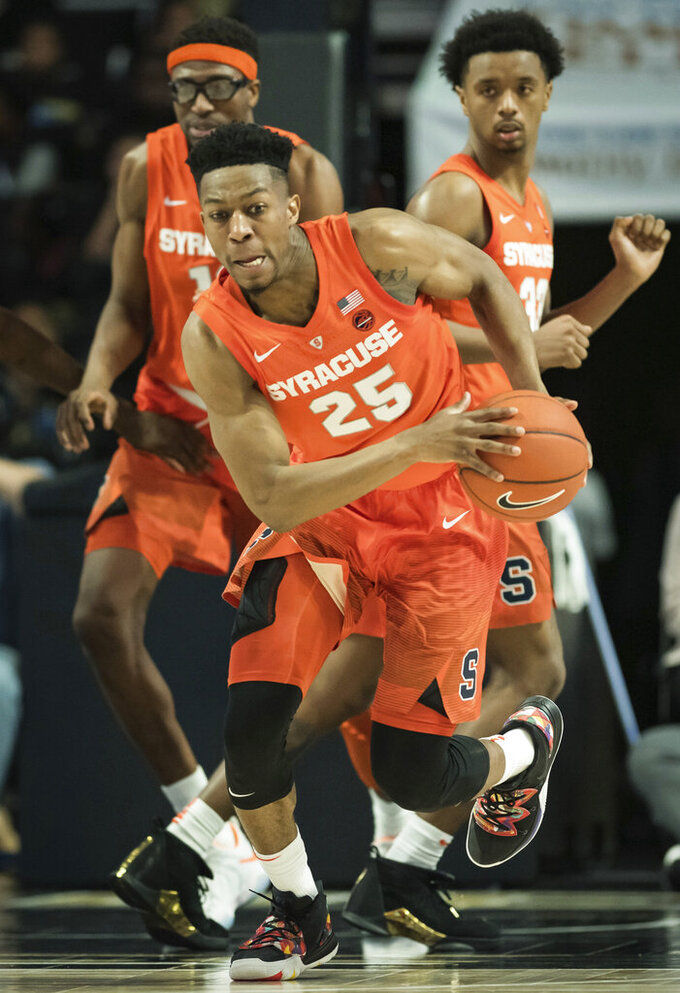 Syracuse guard Tyus Battle (25) takes the ball up the court against Wake Forest during the second half of an NCAA college basketball game, Saturday, March 2, 2019, at Joel Coliseum in Winston-Salem, N.C. (Allison Lee Isley/The Winston-Salem Journal via AP)