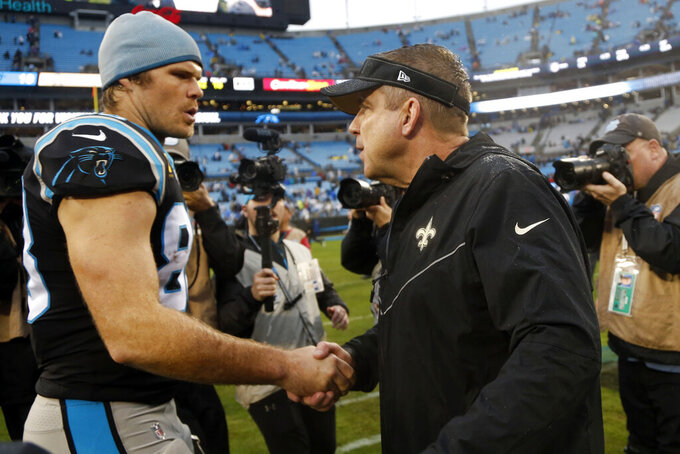 Carolina Panthers tight end Greg Olsen (88) speaks with New Orleans Saints head coach Sean Payton following an NFL football game in Charlotte, N.C., Sunday, Dec. 29, 2019. (AP Photo/Brian Blanco)