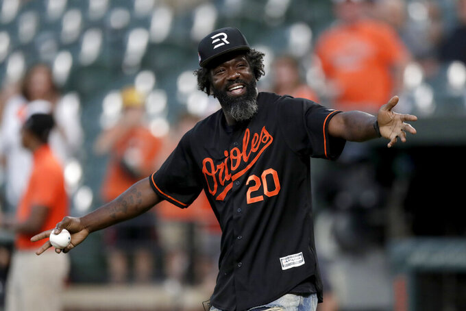 Pro Football Hall of Fame safety Ed Reed is introduced on the field prior to throwing out a ceremonial first pitch during a baseball game between the Baltimore Orioles and the Toronto Blue Jays, Tuesday, Sept. 17, 2019, in Baltimore. (AP Photo/Julio Cortez)