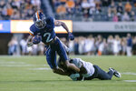 Virginia wide receiver Ra'Shaun Henry (2) is taken down by a Wake Forest player during an NCAA college football game Friday, Sept. 24, 2021, in Charlottesville, Va. (Erin Edgerton/The Daily Progress via AP)