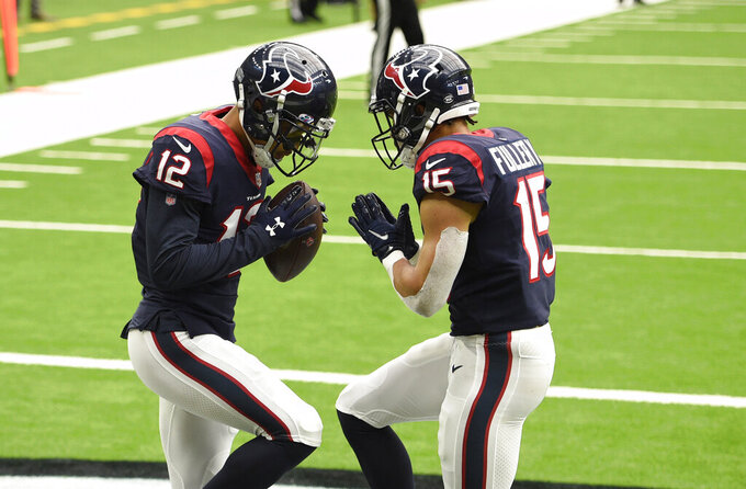 Houston Texans wide receiver Kenny Stills (12) celebrates his touchdown catch against the Minnesota Vikings with teammate Will Fuller (15) during the second half of an NFL football game Sunday, Oct. 4, 2020, in Houston. (AP Photo/Eric Christian Smith)