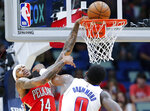 New Orleans Pelicans forward Brandon Ingram (14) draws a foul while dunking over Detroit Pistons center Andre Drummond (0) in the first half of an NBA basketball game in New Orleans, Monday, Dec. 9, 2019. (AP Photo/Brett Duke)