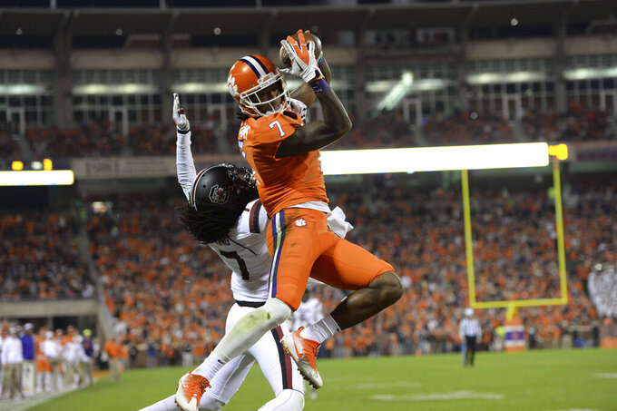 Clemson's Mike Williams pulls in a touchdown reception while defended by South Carolina's Jamarcus King during the first half of an NCAA college football game, Saturday, Nov. 26, 2016, in Clemson, S.C. (AP Photo/Richard Shiro)
