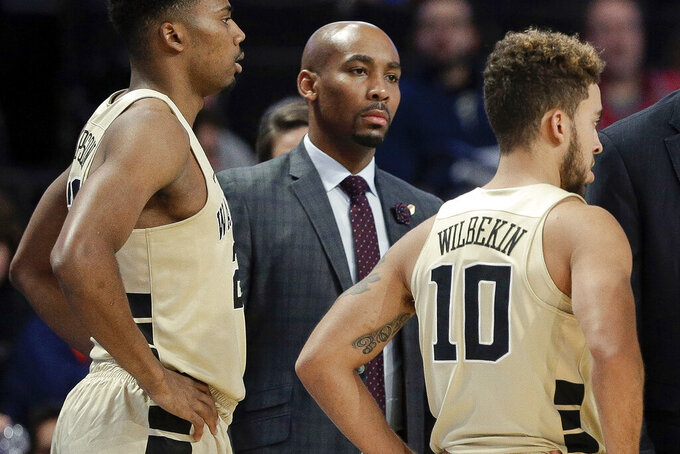 This Nov. 28, 2017 file photo shows former Wake Forest assistant coach Jamill Jones, center, during the second half of an NCAA college basketball game in Winston-Salem, N.C. A jury in Queens criminal court found Jones guilty of misdemeanor assault, on Thursday, for the punch that killed 35-year-old Sandor Szabo in August 2018.(AP Photo/Chuck Burton)