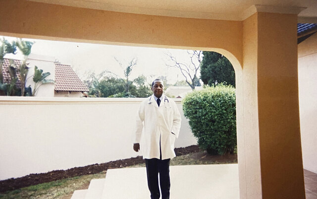 In this undated photo supplied courtesy of the Mini family, the late South African doctor and activist Dr. Clarence Mini is photographed in his doctors' uniform. Clarence Mini, a South African activist and doctor who died of COVID-19 spent his life fighting apartheid, the government's denial of HIV/AIDS and rampant corruption. Loved ones say Mini knew the odds were against him but he was committed to what he believed was right. He died in May, 2020 at age 69. (Photo courtesy of the Mini family via AP)