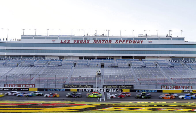 Drivers pass the start finish line during a NASCAR Cup Series auto race Sunday, Sept. 27, 2020, in Las Vegas. (AP Photo/Isaac Brekken)