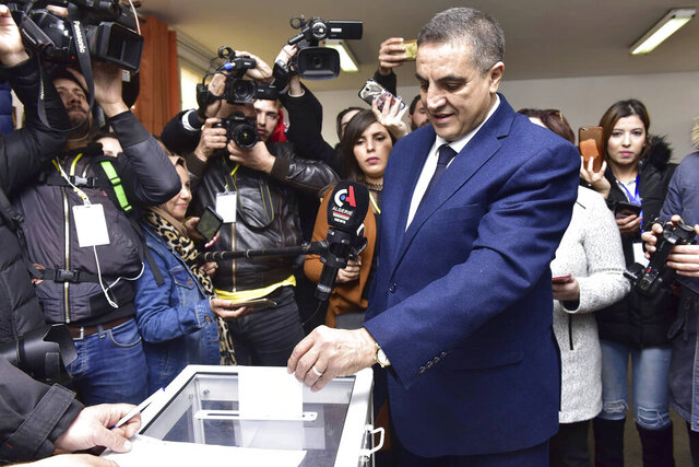 Presidential candidate Abdelaziz Belaid casts his ballot inside a polling station, in Algiers, Algeria, Thursday, Dec. 12, 2019. Five candidates have their eyes on becoming the next president of Algeria - without a leader since April - in Thursday's contentious election boycotted by a massive pro-democracy movement. (AP Photo)
