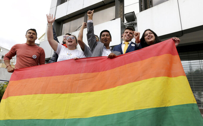 Efrain Soria, center, celebrates with other leaders of the gay community after the legalization of same-sex marriage, outside the court in Quito, Ecuador, Wednesday, June 12, 2019. Ecuador now joins a handful of Latin American nations — Argentina, Brazil, Costa Rica, Colombia and Uruguay — that have legalized same-sex marriage either through judicial rulings, or less frequently, legislative action. (AP Photo/Soledad Nunez)