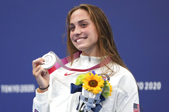 Emma Weyant, of United States, poses with her silver medal on the podium for the women's 400-meter Individual medley at the 2020 Summer Olympics, Sunday, July 25, 2021, in Tokyo, Japan. (AP Photo/Matthias Schrader)