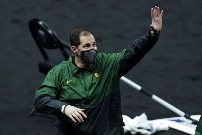 Baylor head coach Scott Drew waves to fans as he leaves the court after a win over Hartford in a college basketball game in the first round of the NCAA tournament at Lucas Oil Stadium in Indianapolis Friday, March 19, 2021, in Indianapolis, Tenn. (AP Photo/Mark Humphrey)