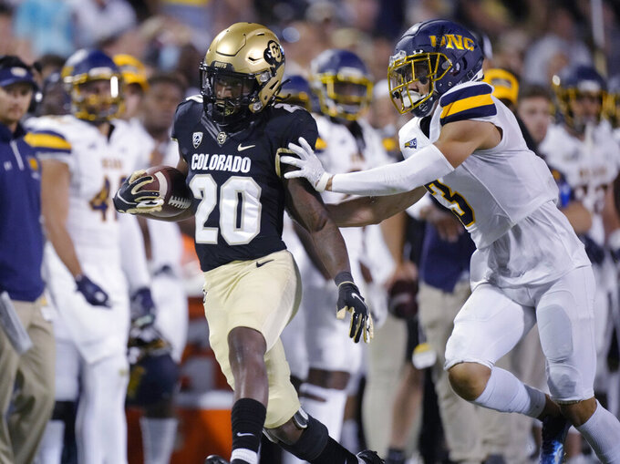 Northern Colorado defensive back Aaron Harris, right, pushes Colorado running back Deion Smith out of bounds after a long gain during the second half of an NCAA college football game Friday, Sept. 3, 2021, in Boulder, Colo. Colorado won 35-7. (AP Photo/David Zalubowski)