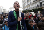Algerian people take to the streets in the capital Algiers to reject the presidential elections and protest against the government, in Algiers, Algeria, Tuesday, Dec. 17, 2019. Algeria's Constitutional Council has confirmed Abdelkader Tebboune as the new president of Africa's largest country for the next five years — despite mass protests challenging his election. (AP Photo/Toufik Doudou)