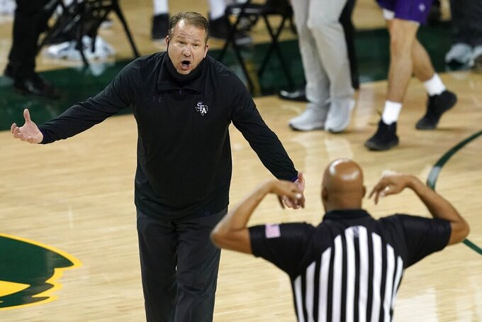 Stephen F. Austin coach Kyle Keller shouts to an official after a timeout was called during the second half of the team's NCAA college basketball game against Baylor in Waco, Texas, Wednesday, Dec. 9, 2020. (AP Photo/Tony Gutierrez)
