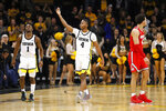 Iowa guard Bakari Evelyn (4) and Joe Toussaint (1) celebrate in front of Ohio State guard Duane Washington Jr., right, at the end of an NCAA college basketball game, Thursday, Feb. 20, 2020, in Iowa City, Iowa. Iowa won 85-76. (AP Photo/Charlie Neibergall)