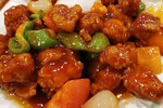"This Nov. 28, 2019, photo shows a plate of sweet and sour pork served at a Chinese restaurant in New York City.  A social media campaign backed by a Japanese seasonings company is targeting the persistent idea that Chinese food is packed with MSG and can make you sick. So entrenched is the notion in American culture, it shows up in the dictionary: Merriam-Webster.com lists ""Chinese restaurant syndrome."