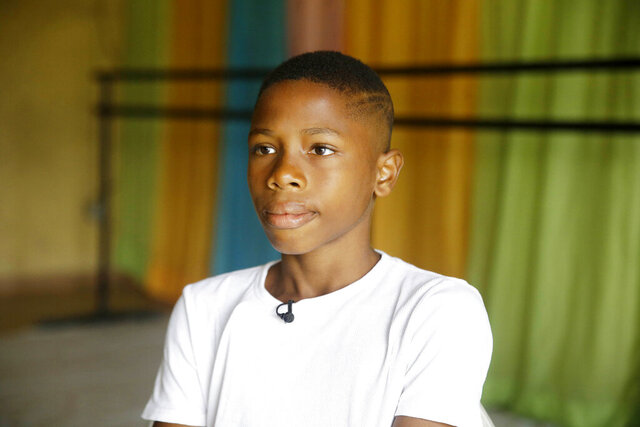 Ballet dancer Anthony Mmesoma Madu appears in his dance studio in Lagos, Nigeria on Aug. 18, 2020. Cellphone video showing the 11-year-old dancing barefoot in the rain went viral on social media. Madu's practice dance session was so impressive that it earned him a ballet scholarship with the American Ballet Theater in the U.S. (AP Photo/Sunday Alamba)