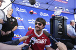 Quarterback of the NFL football Jacksonville Jaguars and former Washington State quarterback Gardner Minshew speaks with members of the media before an NCAA college football game between Washington State and UCLA in Pullman, Wash., Saturday, Sept. 21, 2019. (AP Photo/Young Kwak)