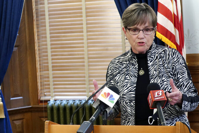 Kansas Gov. Laura Kelly discusses an executive order requiring mask wearing and daily temperature checks in all public and private K-12 schools during a news conference, Monday, July 20, 2020, at the Statehouse in Topeka, Kan. Kelly also wants to delay the reopening of schools from mid-August to after Labor Day but needs the State Board of Education's approval. (AP Photo/John Hanna)