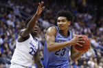 Villanova's Jermaine Samuels (23) drives against Seton Hall's Myles Cale, left, during the first half of an NCAA college basketball game, Wednesday, March 4, 2020, in Newark, N.J. (AP Photo/John Minchillo)