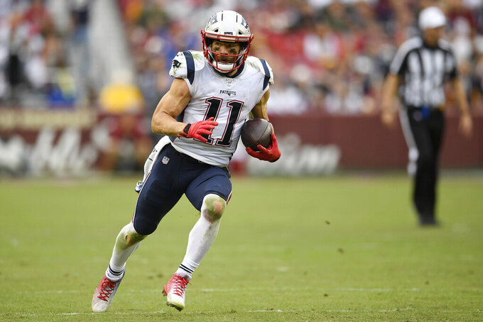 New England Patriots wide receiver Julian Edelman (11) runs against the Washington Redskins during the second half of an NFL football game, Sunday, Oct. 6, 2019, in Washington. (AP Photo/Nick Wass)