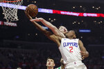 Los Angeles Clippers' Shai Gilgeous-Alexander, front, is fouled by Boston Celtics' Gordon Hayward as he goes up for a basket during the first half of an NBA basketball game, Monday, March 11, 2019, in Los Angeles. (AP Photo/Jae C. Hong)