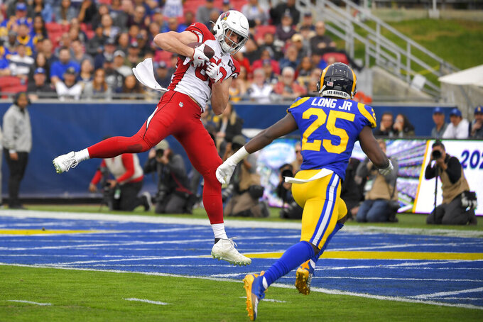 Arizona Cardinals tight end Dan Arnold catches a touchdown pass in front of Los Angeles Rams defensive back David Long during first half of an NFL football game Sunday, Dec. 29, 2019, in Los Angeles. (AP Photo/Mark J. Terrill)