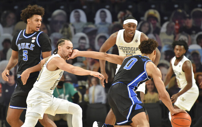 Georgia Tech guard Jose Alvarado (10) is hit by Duke forward Wendell Moore Jr. (0) during the first half of an NCAA college basketball game Tuesday, March 2, 2021, in Atlanta. (Hyosub Shin/Atlanta Journal-Constitution via AP)