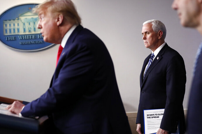 President Donald Trump speaks about the coronavirus in the James Brady Press Briefing Room of the White House, Thursday, April 9, 2020, in Washington, as Vice President Mike Pence and Labor Secretary Eugene Scalia listen. (AP Photo/Andrew Harnik)