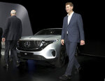 Daimler CEO Dieter Zetsche, left, and incoming Daimler CEO Ola Kaellenius, right, walk past a Mercedes car prior to the annual shareholder meeting of the car manufacturer Daimler in Berlin, Germany, Wednesday, May 22, 2019. (AP Photo/Michael Sohn)