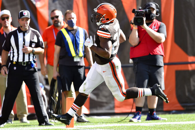 Cleveland Browns running back Nick Chubb rushes for a 26-yard touchdown during the second half of an NFL football game against the Houston Texans, Sunday, Sept. 19, 2021, in Cleveland. (AP Photo/David Richard)