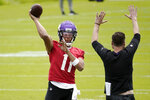 Minnesota Vikings rookie quarterback Kellen Mond throws during NFL football practice in Eagan, Minn., Wednesday, June 2, 2021.(AP Photo/Jim Mone)