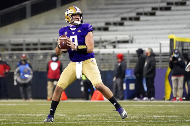 Washington quarterback Dylan Morris drops back to pass against Utah during the second half of an NCAA college football game Saturday, Nov. 28, 2020, in Seattle. (AP Photo/Ted S. Warren)