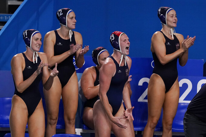 United States players cheer during their win over Spain in the women's water polo gold medal match at the 2020 Summer Olympics, Saturday, Aug. 7, 2021, in Tokyo, Japan. (AP Photo/Mark Humphrey)