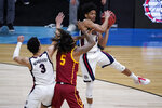 Gonzaga guard Aaron Cook, grabs a rebound over Southern California guard Isaiah White (5) during the first half of an Elite 8 game in the NCAA men's college basketball tournament at Lucas Oil Stadium, Tuesday, March 30, 2021, in Indianapolis. (AP Photo/Darron Cummings)