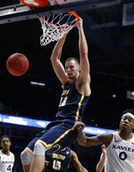 Toledo center Luke Knapke (30) dunks against Xavier forward Tyrique Jones (0) during the second half of a first-round NIT college basketball game Wednesday, March 20, 2019, in Cincinnati. (AP Photo/Gary Landers)