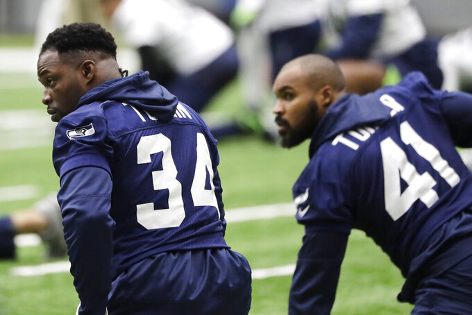 Seattle Seahawks running back Robert Turbin, left, stretches next to practice squad running back Xavier Turner, right, before NFL football practice, Friday, Dec. 27, 2019, in Renton, Wash. (AP Photo/Ted S. Warren)
