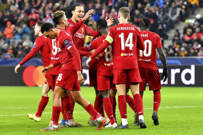 Liverpool's Naby Keita,center, celebrates with teammates after scoring his side's opening goal during the group E Champions League soccer match between Salzburg and Liverpool, in Salzburg, Austria, Tuesday, Dec. 10, 2019. (AP Photo/Kerstin Joensson)