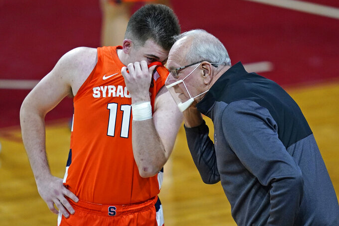 Syracuse head coach Jim Boeheim instructs guard Joseph Girard III (11) during the first half of an NCAA college basketball game against Boston College, Saturday, Dec. 12, 2020, in Boston. (AP Photo/Elise Amendola)